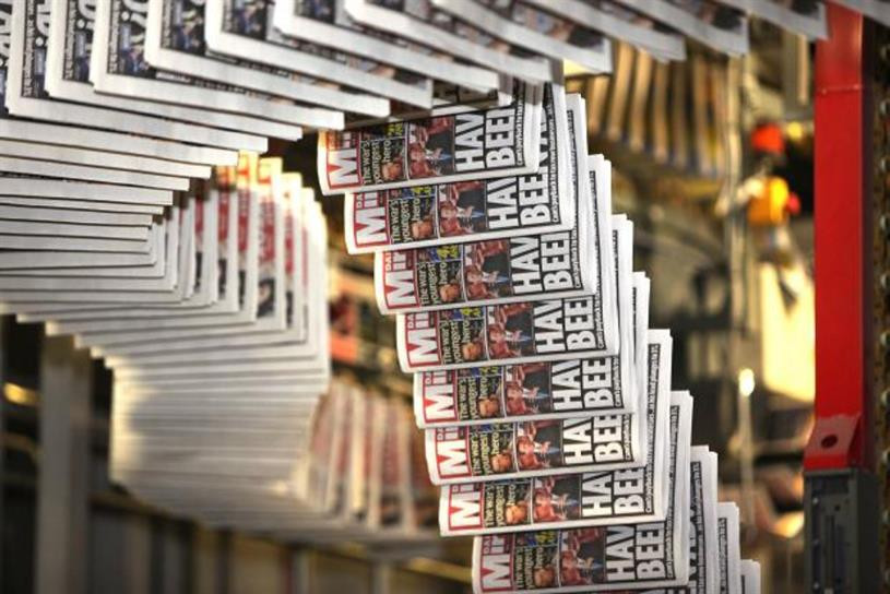 Daily Mirror owner agrees 127 mln stg deal to buy Express titles