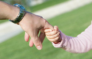 s300_TS100517467_-_Tiny_hand_holding_an_adult_s_hand