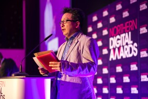 Thinking Digital founder Herb Kim presents an award