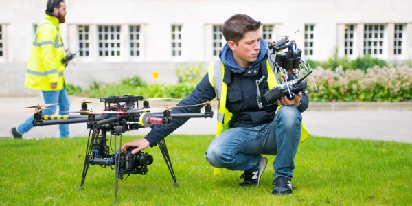 Alec with one of IronBird's unmanned aerial vehicles, with Rob in the background