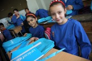 On 16 September 2014 in the Syrian Arab Republic, girls in Grade 3 sit with the school bags and stationery supplies they have just received at their school in central Damascus, the capital. The bags and supplies bear the UNICEF logo. The country's schools reopened on 14 September. To encourage children to return to learning, UNICEF launched a national media campaign to raise public awareness about the importance of education and convey key information on school registration. The campaign's messages were disseminated through such methods as a short radio programme, mobile Short Message Service (SMS), billboards, posters and flyers. UNICEF and partners also distributed school bags with essential stationery supplies to 1 million conflict-affected primary-school-aged children in nearly 300 sub-districts in all 14 governorates.