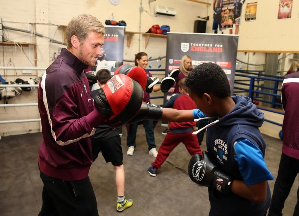 Manchester United striker at a boxing club in Moss Side recently