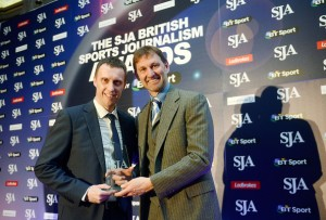Mark Ogden receives Sports Journalism Award from Tony Adams