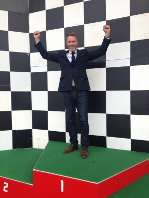 Angus Armitage, director at DS.Emotion, on the podium at Silverstone