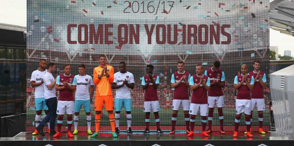 LONDON, ENGLAND - JULY 16: West Ham United players pose in the new West Ham United 2016/17 home kit during the West Ham United kit launch event at the West Ham United Stadium Store, Queen Elizabeth Olympic Park on July 16, 2016 in London, England.  (Photo by West Ham United FC/West Ham United via Getty Images)
